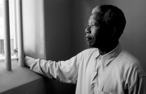 Mandela gazing through bars at former prison